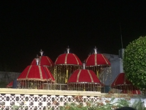RED UMBRELLAS OF WEDDING PROCESSION