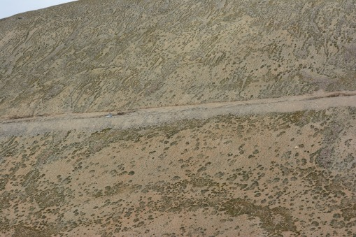 can-you-see-the-tiny-car-on-the-massive-mountain-road