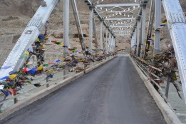 prayer-flags-on-a-bridge-a-tradition
