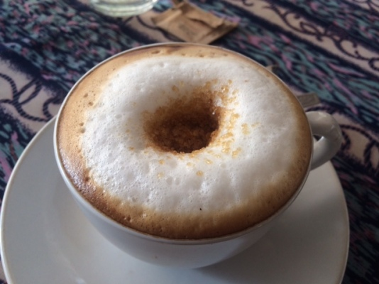 A DELICIOUS CAPPUCCINO THAT LOOKS LIKE A DONUT