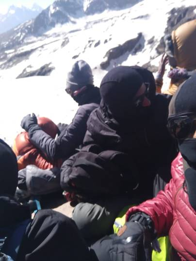 HUDDLED TOGETHER AT THE TOP OF THE PASS PHOTO CREDIT - NIRVI
