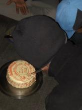 KIRAN CUTTING THE CAKE