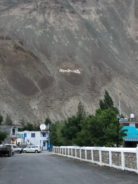 TIBETAN PRAYER PAINTED ON THE MOUNTAIN